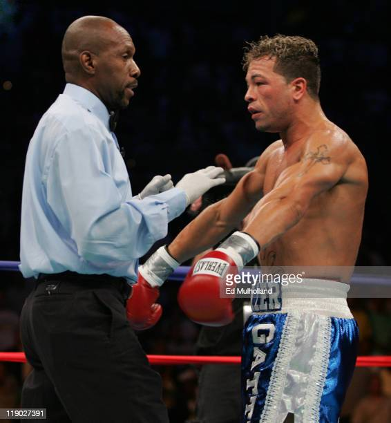 WBC Junior Welterweight Champion Arturo Gatti argues a knockdown with referee Earl Morton during his 12 round bout against Floyd Mayweather at...