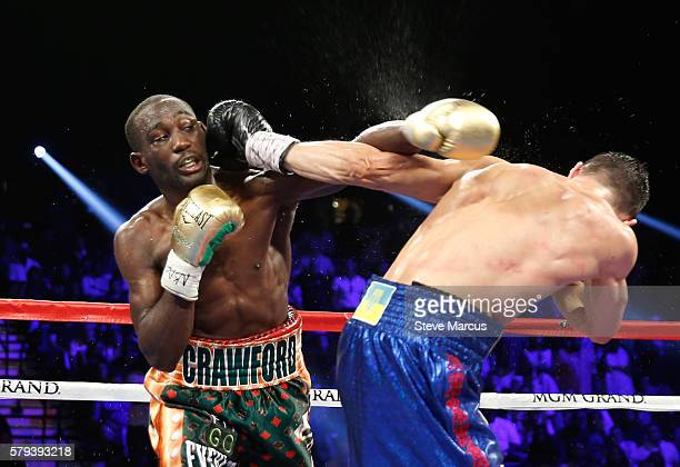WBO junior welterweight champion Terence Crawford battles with WBC champion Viktor Postol of Ukraine during their unification fight at MGM Grand...