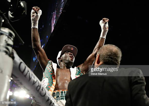 WBO junior welterweight champion Terence Crawford celebrates his unanimous decision victory over WBC champion Viktor Postol of Ukraine at MGM Grand...