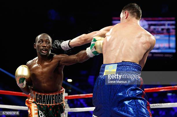 WBO junior welterweight champion Terence Crawford lands a body shot on WBC champion Viktor Postol of Ukraine during their unification fight at MGM...