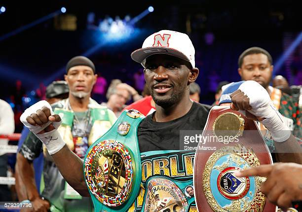 WBO junior welterweight champion Terence Crawford poses with belts after his unanimous decision victory over WBC champion Viktor Postol of Ukraine at...