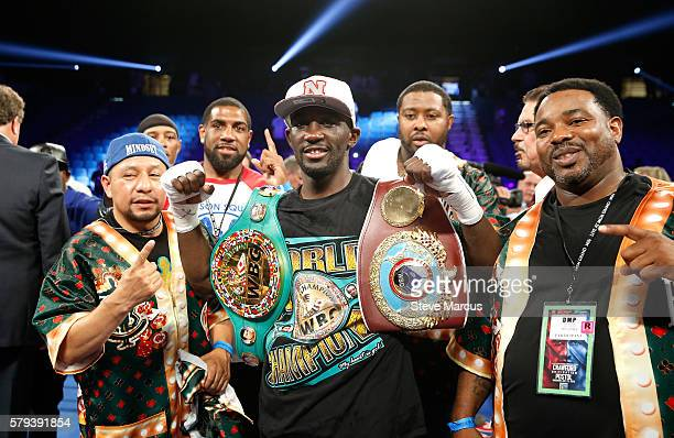 WBO junior welterweight champion Terence Crawford poses with members of his team after his unanimous decision victory over WBC champion Viktor Postol...