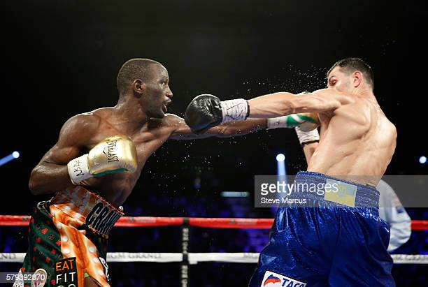 WBO junior welterweight champion Terence Crawford punches WBC champion Viktor Postol of Ukraine during their unification fight at MGM Grand Garden...