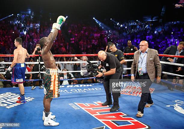 WBO junior welterweight champion Terence Crawford raises his arms in victory after going 12 rounds against WBC champion Viktor Postol of Ukraine at...