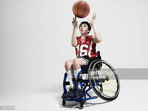 junior wheelchair basketball player - basketball sport stock pictures, royalty-free photos & images