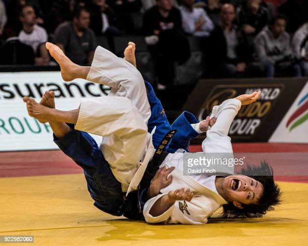 Junior World champion Uta Abe of Japan screams with joy as she throws Charline Van Snick of Belgium for an ippon to reach the u52kg final where she...