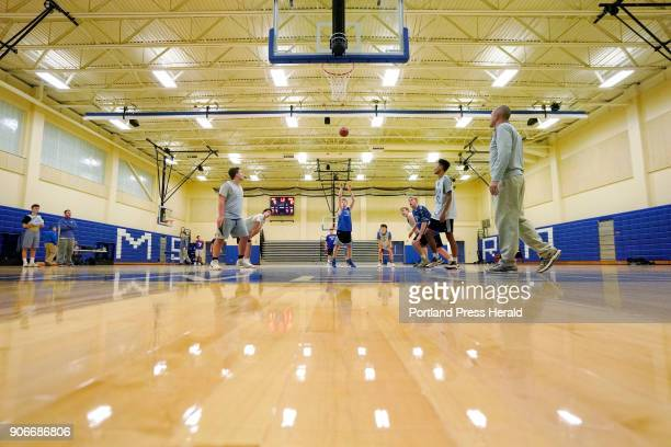 Junior Zack Sullivan throws up a free throw during a practice of the Kennebunk High School varsity high school basketball team in their newly...