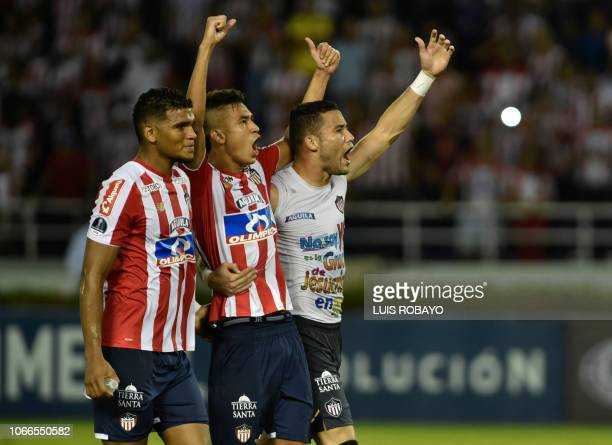 Junior's goalkeeper Sebastian Viera and players Victor Cantillo and David Murillo celebrate after defeating Independiente Santa Fe 10 and making it...