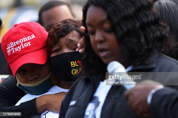 Ju'Niyah Palmer Breonna Taylor's sister wipes away tears from the face of her mother Tamika Palmer Breonna Taylor's mother as Bianca Austin the aunt...