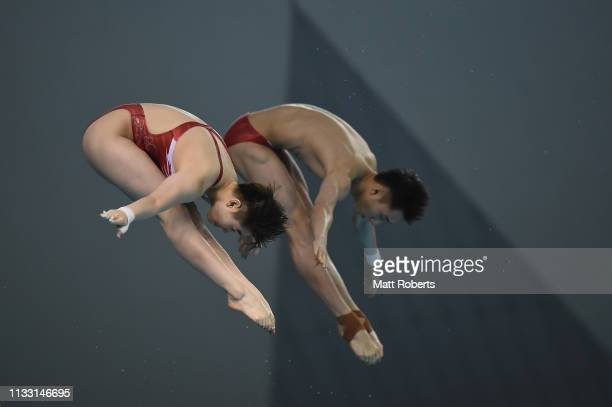 Junjie Lian and Yajie Si of China compete during the Mixed 10m Synchro Platform Final on day two of the FINA Diving World Cup Sagamihara at...