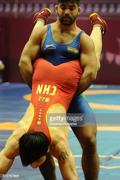 Junjie Na of China competes against Singh Gurpreet of India in the Men's GrecoRoman Senior 75 kg qualification match during the 2016 Wrestling Asian...