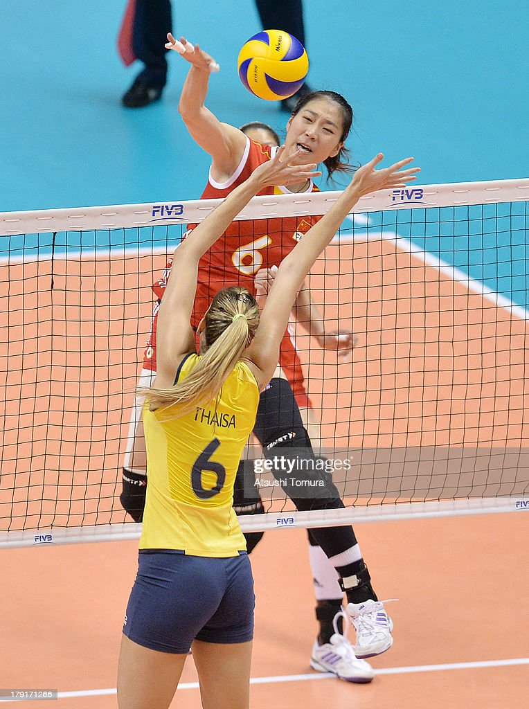 Junjing Yang of China spikes the ball during day five of the FIVB World Grand Prix Sapporo 2013 match between China and Brazil at Hokkaido Prefectural Sports Center on September 1, 2013 in Sapporo, Hokkaido, Japan.