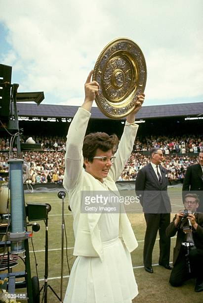 Billie Jean King of the USA holds the trophy aloft after her victory in the Women's Singles event at the Lawn Tennis Championships at Wimbledon in...