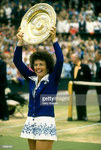 Billie Jean King of the USA holds the trophy aloft after the Lawn Tennis Championships at Wimbledon in London. King won the Women's Singles event. \...