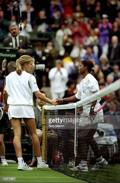 Steffi Graf of Germany shakes hands with Lori McNeil of the USA after their match during the Wimbledon Championships held at the All England Club in...