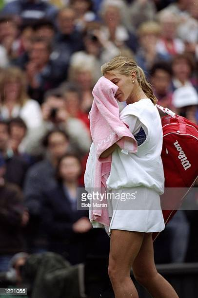Steffi Graf of Germany walks off the court after being beaten by Lori McNeil of the USA during the Wimbledon Championships held at the All England...