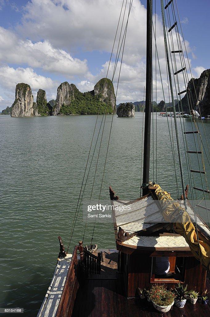Junk boat navigating in Halong Bay : Stock Photo