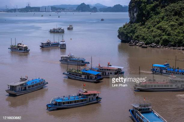 Junk boats carry tourists touring Ha Long Bay after the Vietnamese government eased the lockdown following the coronavirus disease outbreak on May 31...
