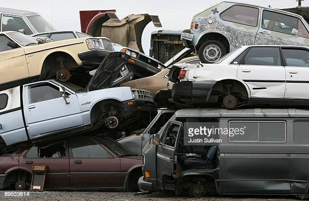 Junk cars are seen stacked at Deal Auto Wrecking July 31 2009 in Richmond California Federal lawmakers are seeking an additional $2 billion to keep...