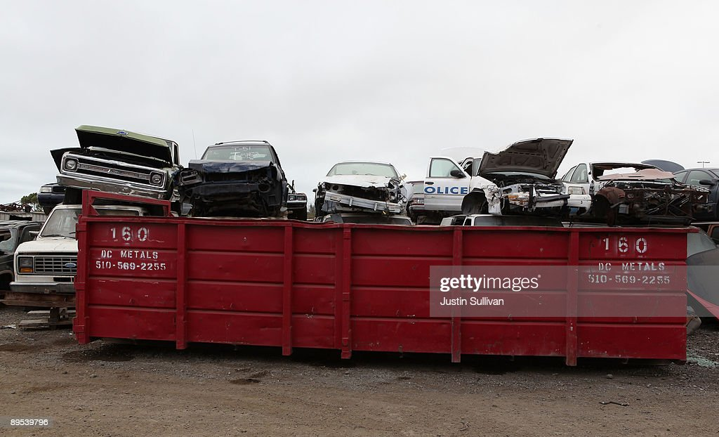 Junk cars are seen stacked near a dumpster at Deal Auto Wrecking July 31, 2009 in Richmond, California. Federal lawmakers are seeking an additional $2 billion to keep the popular 'Cash For Clunkers' program going after the initial $1 billion in funding ran out after a week.