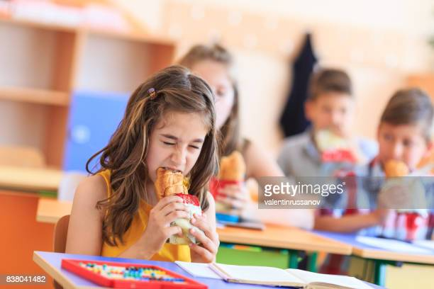 junk food in school - young thick girls stock photos and pictures