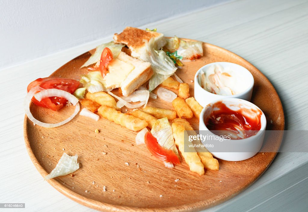 Junk food is wasted or spoiled food and other refuse : Stock-Foto