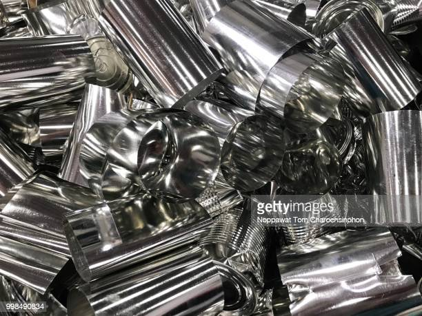 junk tinplate cans waiting to be recycled. - heavy metal stock photos and pictures