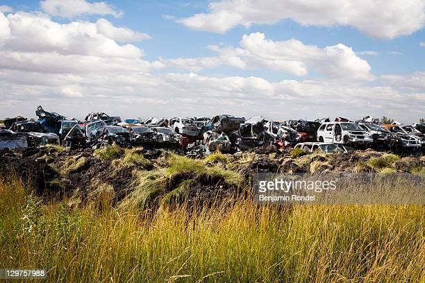 Junk yard in field