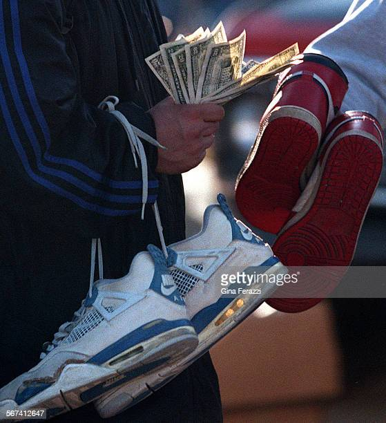 LSJunk40309GF8Japanese tourists pay big bucks for used old model Nike sneakers at the Olde Tyme Flea Market at the Rose Bowl in Pasadena on Sunday...