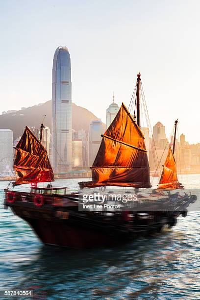 Junkboat sailing across Victoria Harbour, Hong Kong