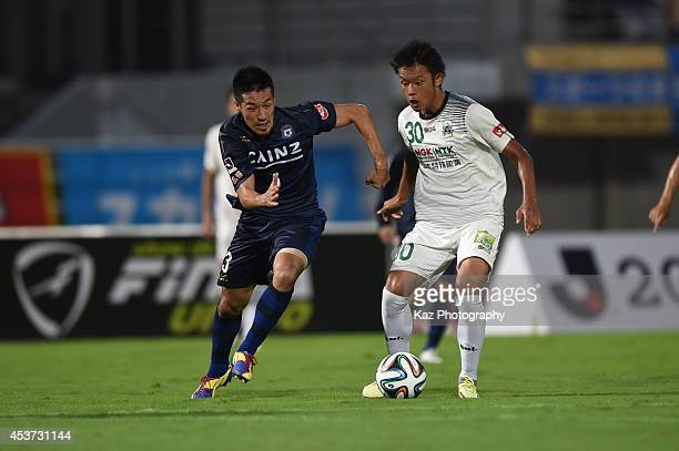 Junki Endo of FC Gifu passes the ball under the pressure from Ryota Aoki of Thespakusatsu Gunma during the J League 2nd division match between...
