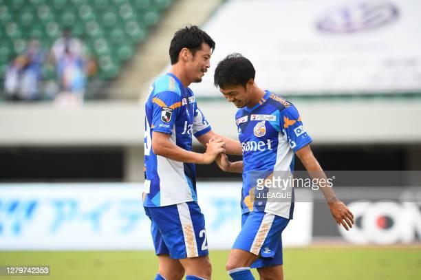 Junki HATA of V-Varen Nagasaki and Takashi SAWADA of V-Varen Nagasaki shake hands after the J.League Meiji Yasuda J2 match between V-Varen Nagasaki...