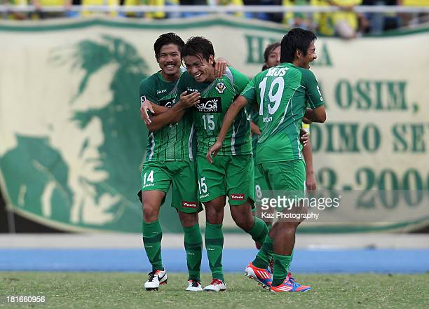 Junki Koike of Tokyo Verdy celebrates scoring his team's first goal with his team mates Jun Suzuki and Yusuke Mori during the JLeague second division...