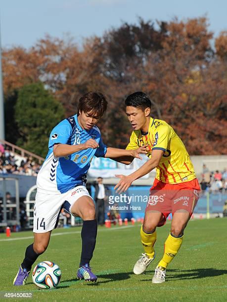 Junki Koike of Yokohama FC and Takayuki Tada of Giravanz Kitakyushu compete for the ball during the JLeague second division match between Yokohama FC...