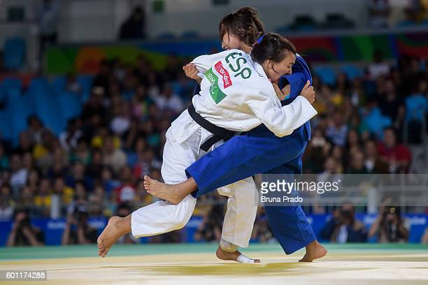 Junko Hirose JPN battles with Maria Monica Herrero Mereciano of Spain during the Women - 57 kg Judo Bronze Medal bout at the Carioca Arena 3 during...