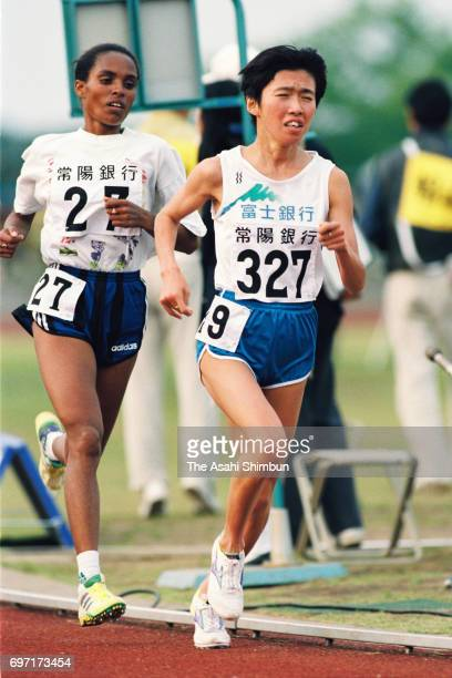 Junko Kataoka of Japan and Derartu Tulu of Ethiopia compete in the Women's 10000m during the Mito International Meets at Mito City Athletic Stadium...