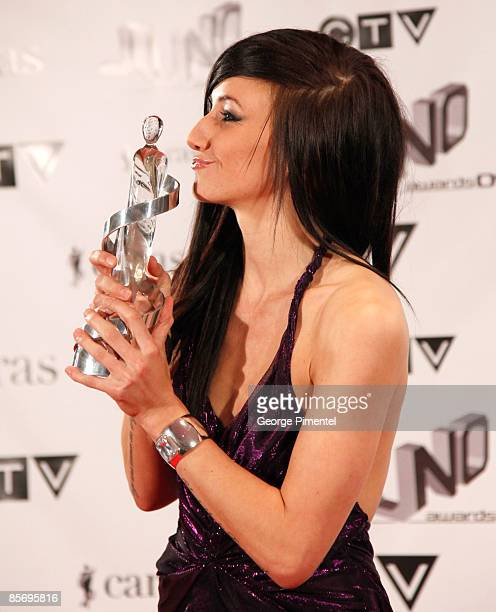 Juno Award Winner for New Artist of the year Lights poses with her award in the press room at the 2009 Juno Awards at General Motors Place on March...