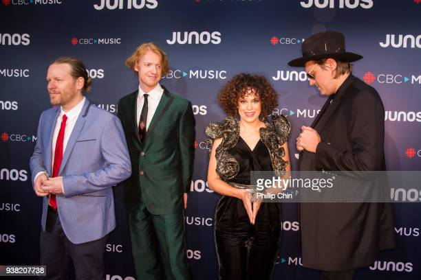 Juno Awards winners Tim Kingsbury Richard Reed Parry Regine Chassagne and Win Butler of Arcade Fire attend the red carpet arrival at the 2018 Juno...