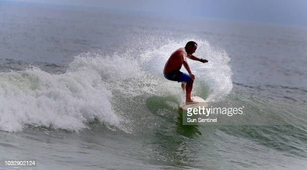 Juno Beach surfer Jamie Vignone of Jupiter, Fla., takes advantage of the strong surf caused by Hurricane Florence as it approaches the Carolinas on...