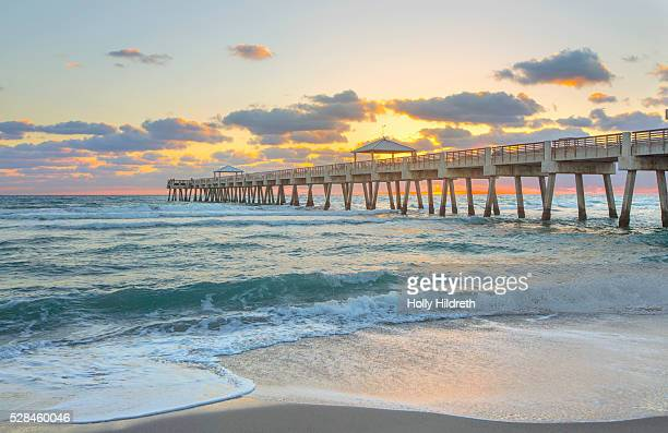 juno pier at sunrise - jupiter florida stock pictures, royalty-free photos & images
