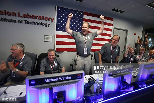 TOPSHOT Juno Project Manager Rick Nybakken celebrates as the solarpowered Juno spacecraft goes into orbit around Jupiter at NASA's Jet Propulsion...