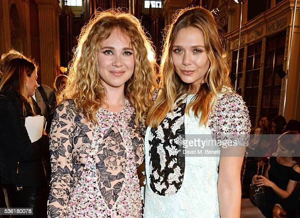 Juno Temple and Elizabeth Olsen attend as Christian Dior showcases its spring summer 2017 cruise collection at Blenheim Palace on May 31 2016 in...