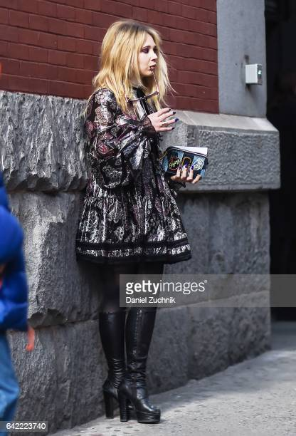 Juno Temple is seen wearing a Marc Jacobs dress outside the Marc Jacobs show during New York Fashion Week Women's Fall/Winter 2017 on February 16...