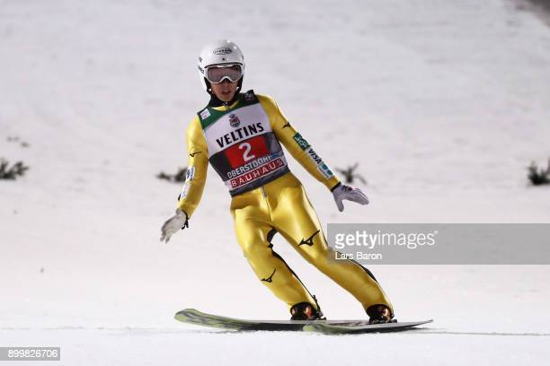 Junshiro Kobayashi of Japan looks on after he competes in the FIS Nordic World Cup on day 2 of the Four Hills Tournament ski jumping event on...