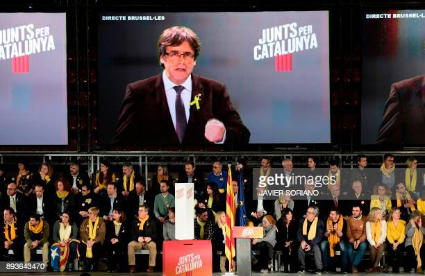 'Junts per Catalonia' JUNTSXCAT grouping candidate for the upcoming Catalan regional election deposed regional president Carles Puigdemont speaks via...