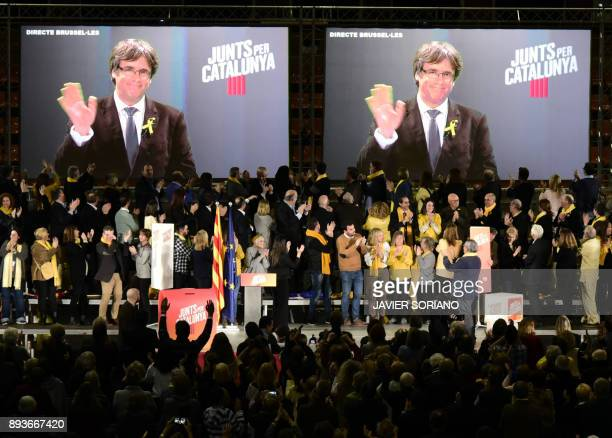TOPSHOT 'Junts per Catalonia' JUNTSXCAT grouping candidates for the upcoming Catalan regional election applaud on stage as main candidate Carles...