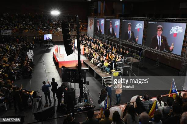 Junts Per Catalunya party candidates for the forthcoming Catalan election listen to deposed regional president Carles Puigdemont as he takes part via...