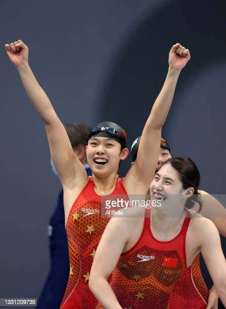 Junxuan Yang, Muhan Tang and Yufei Zhang of Team China react after winning the gold medal in the Women's 4 x 200m Freestyle Relay Final on day six of...
