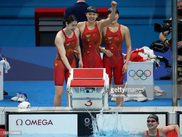 Junxuan Yang, Muhan Tang, Yufei Zhang and Bingjie Li of Team China react after winning the gold medal in the Women's 4 x 200m Freestyle Relay Final...