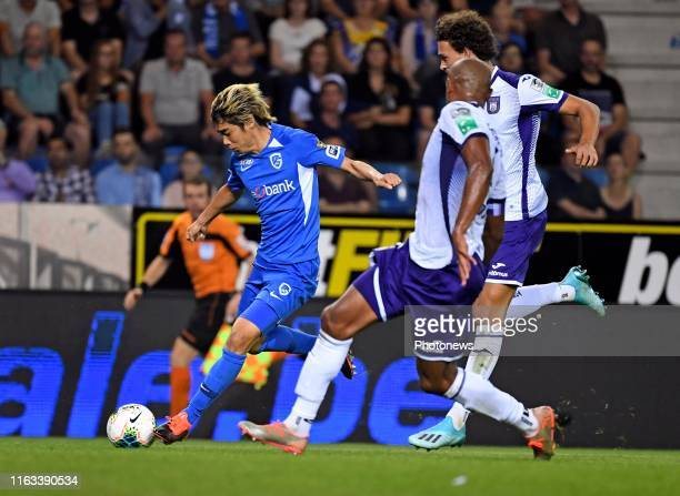 Junya Ito forward of Genk and Philippe Sandler defender of Anderlecht with Vincent Kompany defender of Anderlecht during the Jupiler Pro League match...